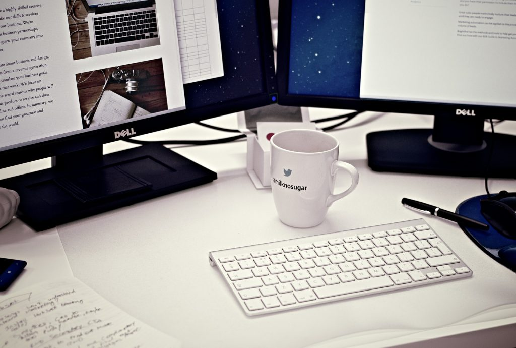 coffee and computer at workstation