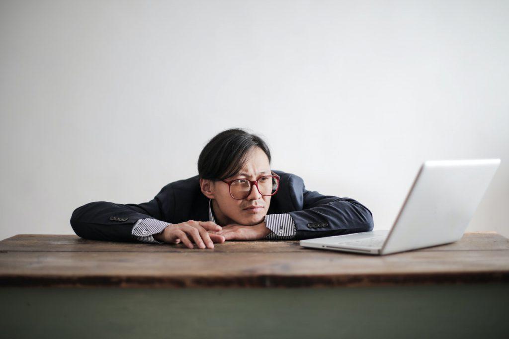 Distressed man looking at computer